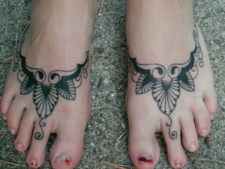 Celtic style tattoo design on foot.