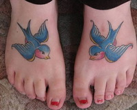 identical Swallow bird tattoo designs on both foot.