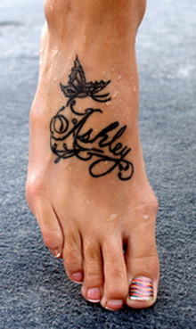 Name emded with the tribal butterfly tattoo design.