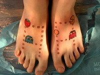 Colorful game catoon tattoo design on both ankle.