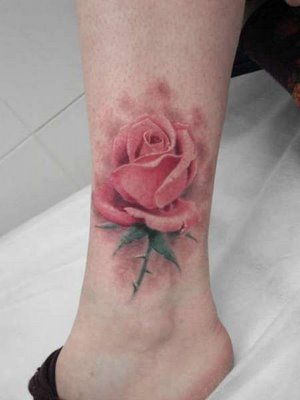 A huge rose flower tattoo for upper ankle.