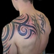 Chopper tattoo on man's shoulder blade, arm and back.