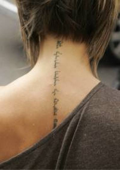 Kabbalah tattoo at the back of Victoria's neck.