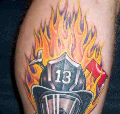 Strong firefightinh tattoo design on man's arm.