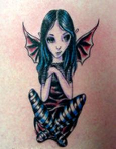 A little gothic fairy tattoo for girls.