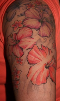 Popular Hawaiian flower tattoo on man's sleeve.