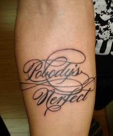 The Italic tattoo on man's forearm.