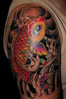 A red and orange color koi fish on man's arm.