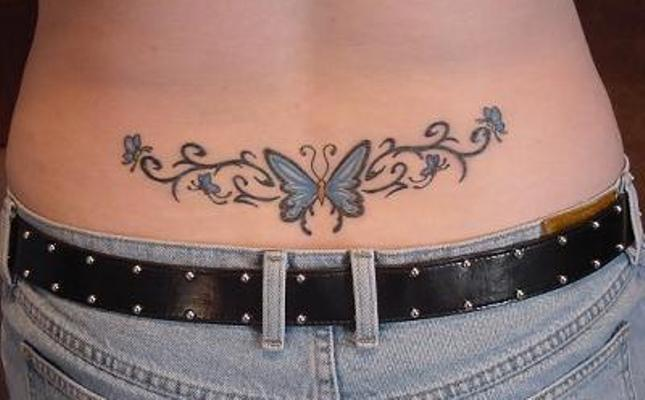 A blue butterfly tattoo at girl's lower back.