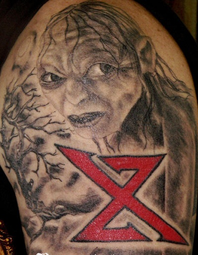 An elf and a red X tattoo for men.