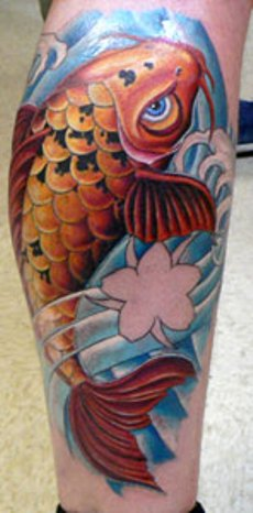 The koi fish tattoo on man's calf.