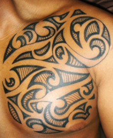 The Maori tattoo on man's left chest and shoulder.