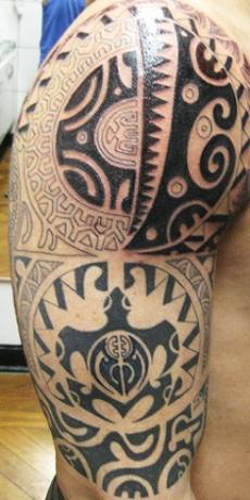 The Maori tattoo on man's right arm.