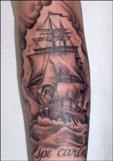 The Miami Ink sailboat tattoo on sleeve.