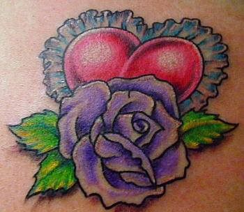 A purple color rose with a red heart tattoo design for feminine.