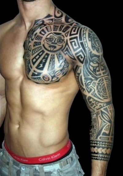 Maori tattoo on man's cleeve and chest.