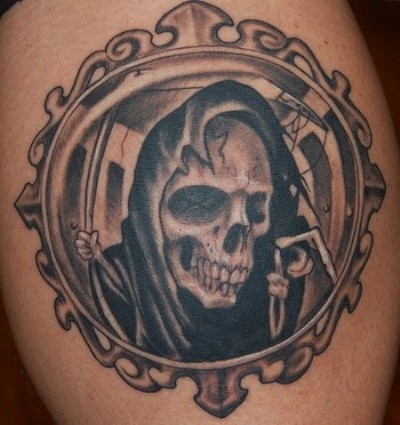 A scary Grim Reaper with circle frame tattoo design for men.