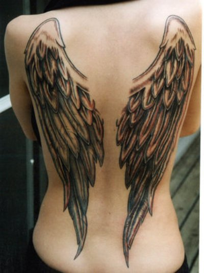 An amazing wings tattoo at girl's full back.