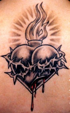 A black heart with barbwire tattoo design for men and women.