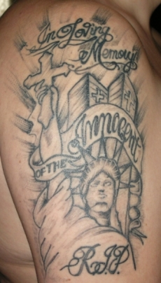 Holding a cross statue liberty tattoo design for men and women.