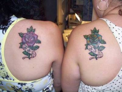 Rose tattoo on sisters's shoulder blade.