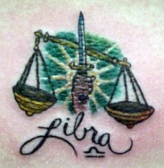 The libra with sword tattoo design for men and women.