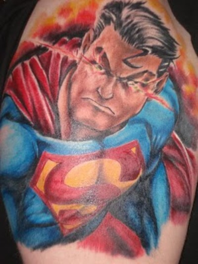 "A superhero ""superman"" tattoo on man's arm."